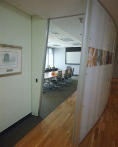 Conference room, with images of current projects on entry wall