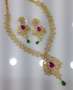 1 gram gold ruby peacock chain with ruby emerald lakshmi pendant classic cz and ruby emerald stone necklace with earrings code sn 1050 price 2795 whatsap to 09581193795 for order processing aloadofball Gallery
