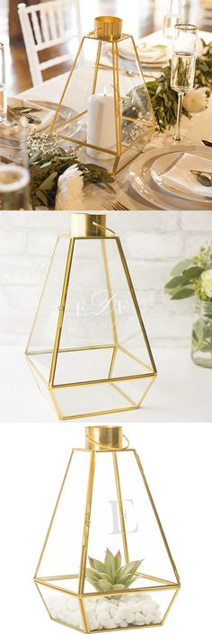 Decorate your wedding reception guest tables with glass candle lanterns personalized with the bride and groom's 3 letter monogram or large married name initial to add romantic candle light to every table. An attractive focal point, glass lanterns can also be used as terrariums for succulent plants for displaying other decorative wedding theme elements. This personalized candle lantern can be purchased at http://myweddingreceptionideas.com/personalized-geometric-candle-lantern-centerpiece.asp