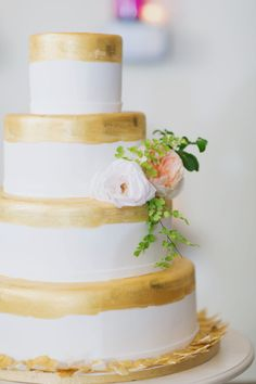 Gold painted wedding cake with delicate flowers: http://www.stylemepretty.com/2014/09/26/classically-elegant-georgia-estate-wedding/ | Photography: Our Labor of Love - http://ourlaboroflove.com/