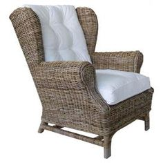 Hand-woven rattan wingback with an aluminum frame. Product: ChairConstruction Material: Aluminum, synthetic rattan, and fabricColor: White and naturalFeatures: Cushion includedDimensions: 37 H x 33 W x 35 D Rattan Armchair, Outdoor Armchair, Wicker Chairs, Rattan Furniture, Chair Cushions, Armchairs, Outdoor Furniture, Pool Furniture, Funky Furniture