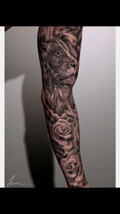 Tattoo arm sleeve lion roses