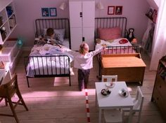 2013 Creative IKEA Kids Room Design Ideas : Adorable Wall Sticker IKEA Shared Kids Room Design with White Closet in the Middle of Twin Beds