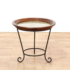 This end table is featured in a polished wrought iron. This traditional side table has a wrought iron base, scroll legs, and wooden bowl top. Perfect for holding drinks! #americantraditional #tables #endtable #sandiegovintage #vintagefurniture