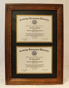 This beautiful double diploma frame has an aged, antique appearance. Perfect for those who love the vintage or distressed look. It's made of solid cherry.