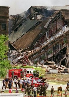 Pentagon building burst into flames and a portion of the five-sided structure collapsed after the west wall of the building was hit by the hijacked American Airlines Flight 77 at a. World Trade Center, Trade Centre, We Will Never Forget, Lest We Forget, Flatiron Building, Nasa, 11 September 2001, Historia Universal, Natural Disasters