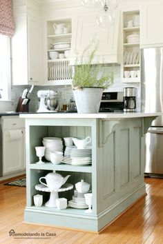 Kitchen Island Makeover - Beadboard and corbels offer decorative gravitas (and highlight a wider countertop that can double as a breakfast bar). Finally, shabby-chic chalk paint in robin's egg blue spiffed the whole thing up.