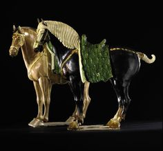Pair of sancai-glazed pottery horses , Tang dynasty, black horse: 27 by 30 inches, roan horse: 26¾ by 30 inches, realized  $4,197,000 at Sot...