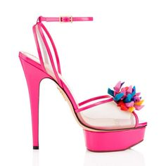 Give any look a feminine flourish with this Barbie® inspired Pomeline. In iconic Barbie pink polished calfskin with translucent mesh detail, this platform pump is perfect for when you want to play dress-up, complete with multi-coloured pom pom made up entirely of doll shoes. POMELINE SANDAL Charlotte Olympia SHOES