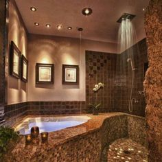 gorgeous sexy romantic bathroom. Love the lights in the jacuzzi tub and the rain shower!!!!!! Yes please =D