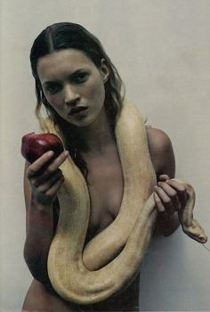 Kate Moss by M. Sorrenti. Possibly a reference to Eve, as she has an apple and a snake.