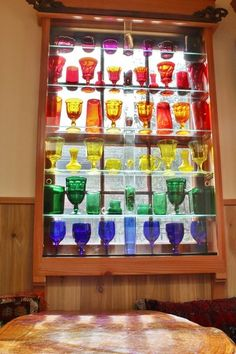 eclectic by Kimberley Bryan. Nice way to display a colored glass collection. Glass Rocks, Glass Art, Glass Shelves In Bathroom, Bathroom Niche, Boho Deco, Rainbow Glass, Rainbow Light, Displaying Collections, Sliding Glass Door