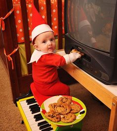 Third time telling this elf not to put cookies in the VCR!  He is fascinated with jamming them in there.