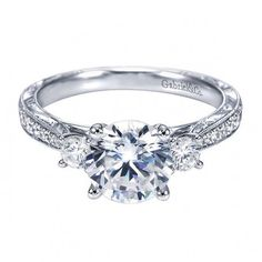 ooooooooh.....i think i am in love!!  Antique Style Three Stone Engagement Ring Setting with Round Side Stones, Antique Style Engraving, and Pave Set Diamonds on a Tapered Shank ...