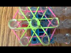 How to make a rainbow loom flower charm - YouTube