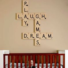 Play Laugh Dream Crossword Wall Art. I have always loved scrabble for it's ability to make word patterns, what a beautiful message to have on the wall.