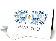 Elegant blank note card featuring a modern folk art style illustration of two blue birds standing opposite to each other. Between them is a heart and they are surrounded by leaves and flowers. Text: Thank you. Blank inside, add your own text.