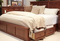 Start the year fresh with this gorgeous storage bed from Gallery Furniture! Rich brown wood, sleek paneling and convenient storage drawers will transform your bedroom and the way you live! Come see us TODAY to experience this beauty for yourself! | Houston TX | Gallery Furniture |