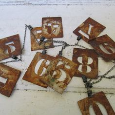 Rusty metal stencil garland numbers on clip chain industrial farm house home decor wall hanging anita spero    I started with a pre-made chain
