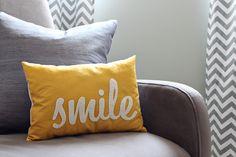 chevron curtains, gray, white, yellow, turquoise, neutral, neutral nursery ideas, nursery, baby, chandelier, white crib, calligraphy, decorative pillows