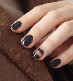 Black and bronze winter nail art design. If you have short nails you can always go for the classic black matte polish. Add a stylish diagonal cut on the ring finger nail lined with chrome metallic polish.