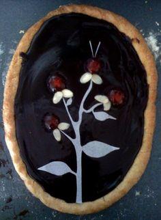 Amazing chocolate Mazurek, Polish Easter cake topped with flower design. http://littlezosienka.wordpress.com/2010/04/05/in-the-tradition-of-mazurek/