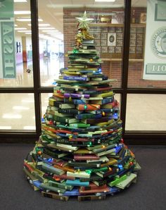 Red Oak High School Media Center's Christmas Tree 2012! Students and staff pitched in and used weeded books. Just shy of 6'. Thank you Pinterest for great ideas!