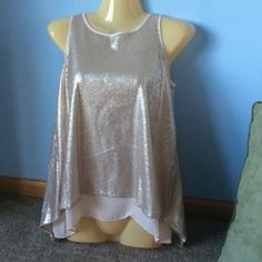 Jennifer Lopez Sequin Tank Light pink bottom with gold sequin overlay. The back has a opening along with the keyhole back. Has a sharkbite fit. Like new condition Jennifer Lopez Tops Tank Tops