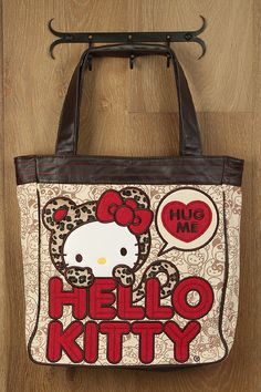 "Hello Kitty Leopard Tote Bag-Not a big Hello Kitty fan but I like this bag...kind of wish it didn't say ""Hug Me"" but otherwise really cute"