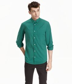 Long-sleeved shirt in washed cotton poplin with a narrow turn-down collar and a chest pocket. Slim fit.