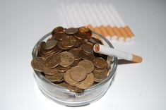 The Economics of Smoking and Real Costs to Society