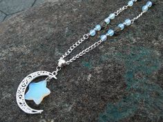 Check out this item in my Etsy shop https://www.etsy.com/listing/219626144/opalite-and-pyrite-flower-moon-necklace
