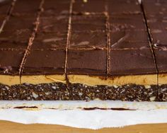 Cappuccino Nanaimo Bars-these bars are sweet and chocolatey with a real kick of coffee! One bite of these are sure to give you a burst of sweetness and energy to help you leap through the day.