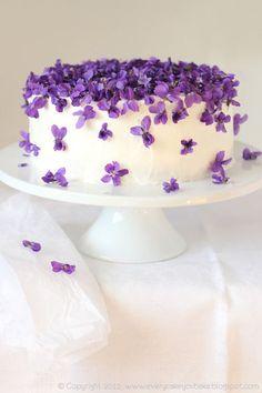 Purple flower wedding cake. Violets - watchfulness, faithfulness.