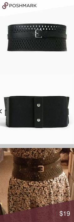 "Torrid Plus Sz 0 Wide Cutout Stretch Belt Wide Cutout Stretch Belt There's statement-making and then there's this belt. The ultra wide black faux leather style has a stretch back with a snap button closure. The black faux leather front shows off with cutouts and a gleaming buckle strap.  4.75"" wide  Man-made materials  Faux leather size Plus 0  I am wearing the 00 in the last pic Torrid Accessories Belts"