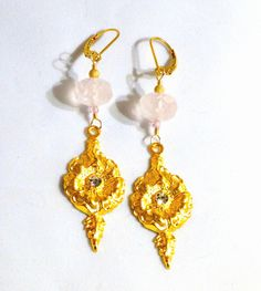 Pink Rose Quartz and satin matte gold flowers, and handset crystals. 14k goldfilled ear hooks.