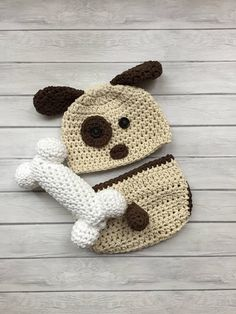 Puppy hat, crochet puppy hat, baby puppy hat, newborn puppy hat, newborn photo prop, dog hat, infant dog hat, crochet dog hat, newborn hat This listing is for one newborn -3 month crochet puppy hat, diaper cover and white dog bone set. Made with cotton yarn so that it is soft and