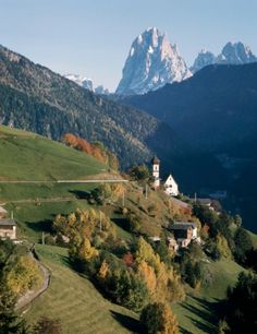 View of town of St Peter, Mount Sassolungo in background, Val Gardena, Trentino-Alto Adige, Italy