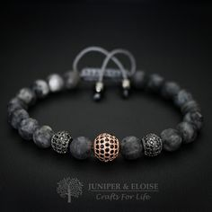 MATTE BLACK & GOLD ZIRCON BRACELETMATTE BLACK & GOLD ZIRCON BRACELET - This beaded bracelet is made with 8mm Grade A Matte Spectrolite beads, featuring Rhodium & Rose gold plated spacer beads embellished with black crystals.