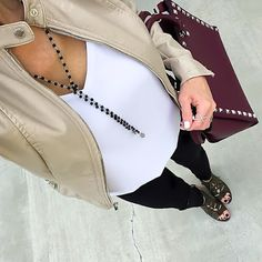 Beige Moto Jacket, White Cami, Black distressed jeans, plum bag | On the Daily EXPRESS | Instagram: @ontheDailyX