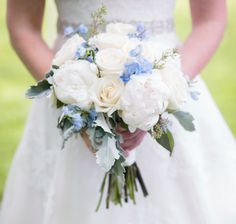 Bride's bouquet: creamy Vendela roses, blush/off-white peonies, seeded eucalyptus, dusty miller, light blue/periwinkle delphinium.