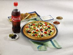 Recharge on FreeCharge.com and select yummy Dominos Pizza instant e-coupons