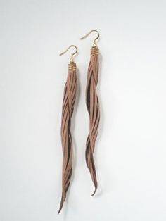 Delicate handcrafted jewelry made from fine leather. Gold-filled hardware and ear hooks.Measures 6 inches from the top of the ear hook to the bottom of drop earring.