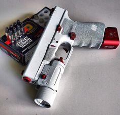Gorgeous Glock 19 in white. Black Talon rounds spotted in the back via Custom Glock, Custom Guns, Weapons Guns, Guns And Ammo, White Glock, Armas Airsoft, Armas Wallpaper, Armas Ninja, Survival