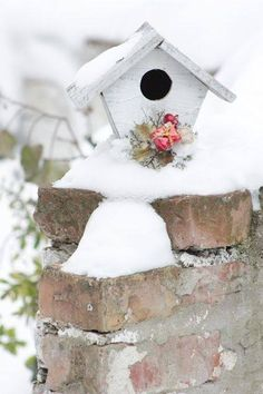 Winter birdhouse with pink flower