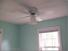 Another ceiling fan redo ... would do something different, but she figured out how to put a lamp shade on a fan with one bulb facing down ...
