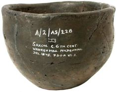 A Saxon pottery urn of plain form with slightly flaring neck, broken and repaired but with negligible loss, red-black surface, inscribed, Saxon, c 6th Cent, Warren Hill, Mildenhall, Dec 1875 ·P·S·I·A VI·I, 3.25in high, 5.25in diameter via auction house Viking Age Art, Sutton Hoo, Anglo Saxon, Dark Ages, Antiquities, Archaeology, Red Black, Vikings, Celtic