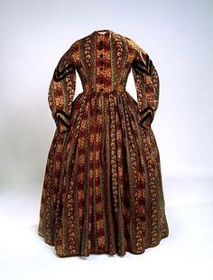 "1860-65 dress of wool challis. This is a perfect example of what ""the average person"" might wear on a day-to-day basis, and looks a lot like what most women were photographed in."