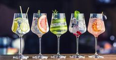 Photo about Five colorful gin tonic cocktails in wine glasses on bar counter in pup or restaurant. Image of drinks, party, environment - 111478962 Champagne Cocktail, Signature Cocktail, Cocktail Drinks, Cocktail Recipes, Cocktail Sauce, Cocktail Movie, Cocktail Attire, Cocktail Shaker, Cocktail Dresses