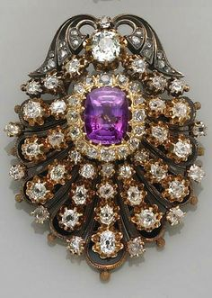 The Estate of Miriam Burzstyn, Chapter 7 Trustee, lots 1-14 An antique purple sapphire, diamond and gold brooch, circa 1890 the shield-shaped pendant centering an oval-cut purple sapphire and old European-cut diamond cluster, the remainder set throughout with old mine and old European-cut diamonds, black enamel detail to borders; sapphire weighing an estimated: 3.95 carats; estimated total diamond weight: 3.05 carats.